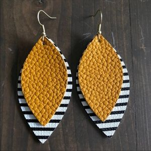 Brand new!!!  Faux leather Mustard striped earring